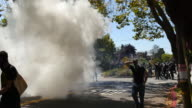 Antifa protesters run after Berkeley Police throw smoke grenades and shoot a rubber bullet at a crowd to break up a fight Protesters had followed...