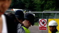 West Sussex Balcombe EXT General views of antifracking protester camp outside Cuadrilla drilling site including posters police at scene protesters...