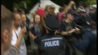 Antifracking protester gets carried away by police officers