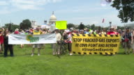 AntiFracking protesters hold up signs in front of the US Capitol Building