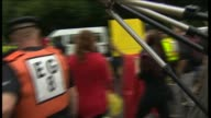 Antifracking protesters march alongside police officers