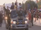 AntiGaddafi fighters parade in Misrata to celebrate their victory over Colonel Gaddafi's forces