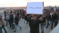 Antigovernment protesters from rural central Tunisia marched through the capital Sunday raising the pressure on Prime Minister Mohammed Ghannouchi to...