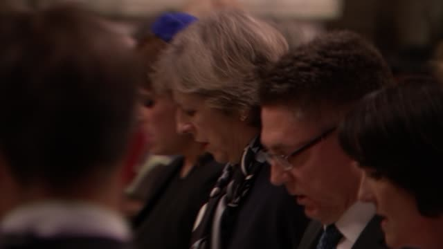 service at Westminster Abbey Service in progress / Princess Eugenie lays wreath / Theresa May seated