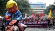 AntiUS protesters burn effigies of US President Donald Trump and Philippine President Rodrigo Duterte at a rally near the US embassy in Manila...
