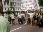 1970 antiVietnam War demonstrators marching with banners / newspaper reporter taking notes / Detroit