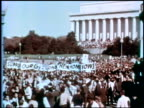 Antiwar demonstration put on by the National Mobilization Committee to End the War in Vietnam / crowds holding banner that says 'Support our GIs...