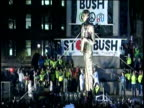 AntiWar protestors tear down forty foot George W Bush effigy statue crowd cheer as protestors jump all over it mocking tearing down of Saddam Hussein...