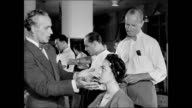 HD Antoine de Paris Salon chairs w/ female clients having hair styled Antoine walking through salon w/ hairstylists working making suggestions...