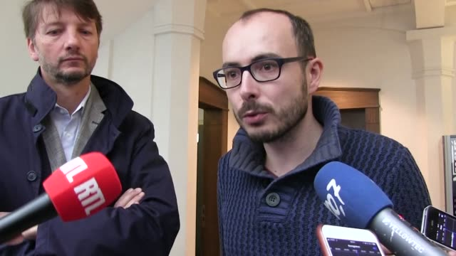Antoine Deltour one of the Luxleaks whistle blowers speaks to reporters outside of a courthouse in Luxembourg