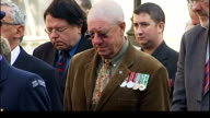 Anzac Day Prime Minister of New Zealand lays wreath at the Cenotaph ENGLAND London Whitehall EXT **Poor quality audio** John Key holding wreath Man...