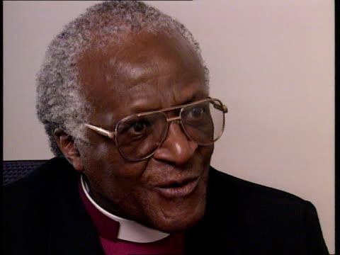 Apartheid commission hearing CMS Archbishop Desmond Tutu intvwd SOT look the beast in the eye EXT MS Ntsiki Biko along walking in field TRACK LR