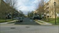 WS Apartment buildings by suburban street / Washington DC, USA