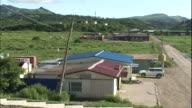 Apartment houses and other private homes line Shakotan Port on Shikotan Island.