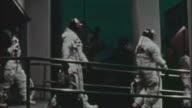 Apollo 11 astronauts walking to bus on morning of their blastoff at Kennedy Space Center / Florida USA