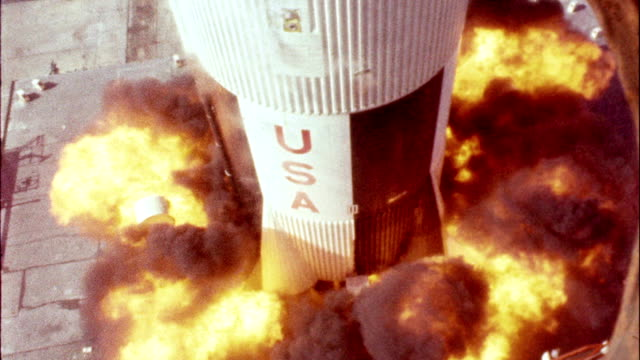Apollo 11 rocket blasting off from launch pad