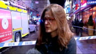 Night general views outside Vox pops / Jess Bowie interview SOT / firefighters fire engines and police officers at scene / paramedics treated people...