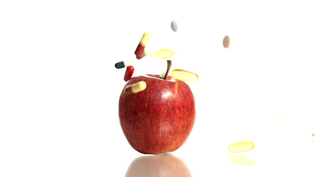 HD SLOW MOTION: Apple And Medicine