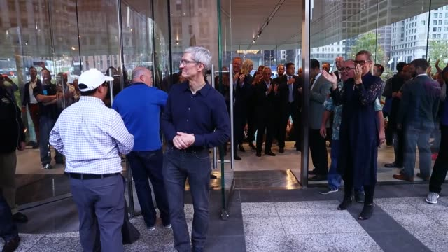 Apple CEO Tim Cook greets guests at the grand opening of Apple's Chicago flagship store on Michigan Avenue October 20 2017 in Chicago Illinois The...