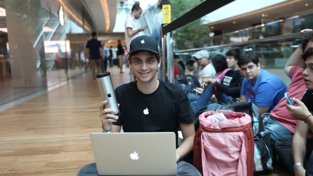 Apple customer waits in line outside of the Apple Inc store in Latin America located at the Village mall in Rio de Janeiro Brazil on Saturday Feb 15...
