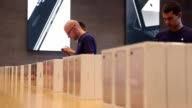 Apple employees prepare Apple iPhone 7 phones on the first day of sales of the new phone at the Berlin Apple store on September 16 2016 in Berlin...