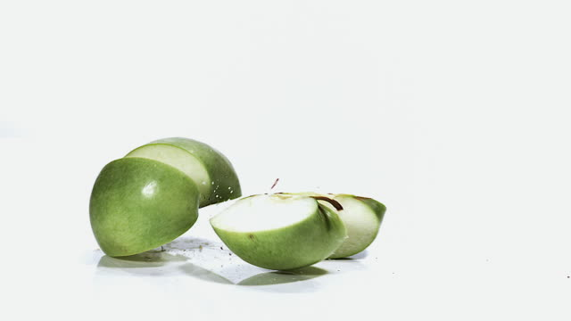 MS SLO MO Apple falling on floor against white background / Vieux Pont, Normandy, France