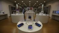 Apple Inc iPad mini tablets sit on a display table inside a reStore premium Apple reseller in Moscow Russia on Thursday Oct 3 An employee polishes...
