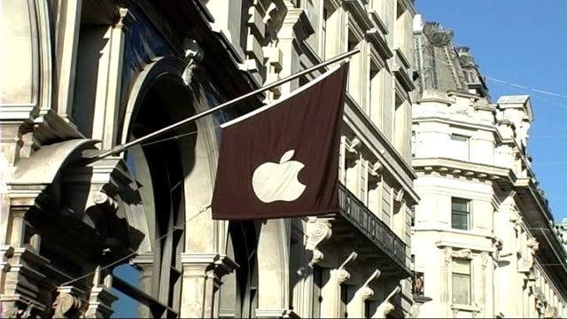Apple iPhone goes on sale amid concerns over 'network locking' **Music overlaid SOT** London EXT Flag with Apple logo on side of building People...
