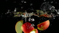 SLOW MOTION: Apple splashing into Water
