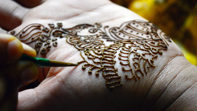 applying henna tattoo macro close up shot