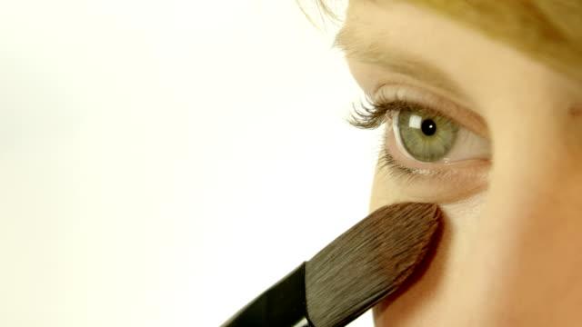 Applying make up on beautiful face