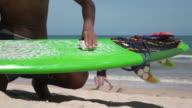 Applying wax on a surfboard