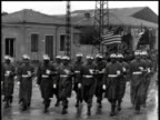 April 01 1944 WS Soldiers carrying American flags marching down street / Korea