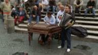 April 24 2006 WS Street musicians playing in front of seated audience / Massachusetts United States
