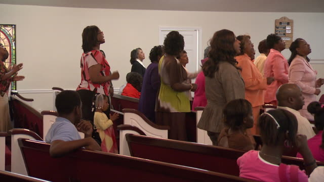 April 24 2010 MS Women singing in church during service / Mississippi United States