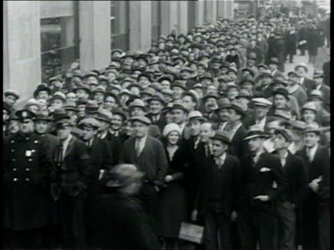 April 6 1933 MONTAGE People waiting in line and bartender pouring beer for crowd at the end of Prohibition / New York City New York United States