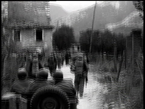 April 8 1945 POV Jeep and soldiers moving down village road / Italy