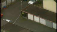 Aerials of Machynlleth WALES Powys Machynlleth of community centre with police vehicles and search teams outside / police van in road / residential...