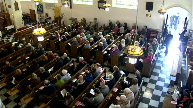 church service held WALES Machynlleth BrynyGog estate St Peter's Church High Angle shots of church service held for missing girl April Jones people...