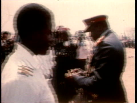 April Ugandan Dictator Idi Amin was deposed in 1979 TX Tanks along in military parade / Idi Amin pinning medals on men's chests / Idi Amin speech SOT