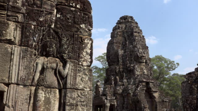 Apsara relief and giant stone face tower of Bayon temple