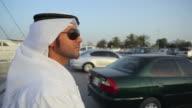 CU PAN Arab man in traditional dish dash standing in car park at Dubai Creek / Dubai, United Arab Emirates