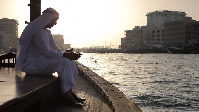 WS Arab man in traditional dress on ferry boat in Dubai Creek/Dubai/UAE