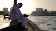 WS Arab man in traditional dress on ferry boat in Dubai Creek/Dubai/UAE
