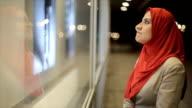 Arab woman watches on  shop window