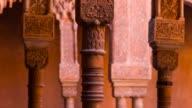 Arabesques around some columns in Alhambra