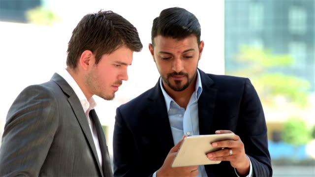 Arabic and western businessman working