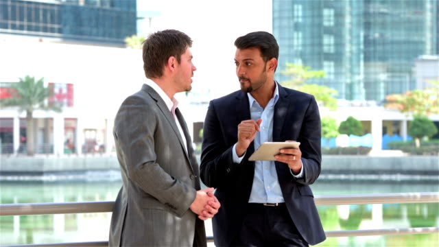 Arabic businessman working with western expat