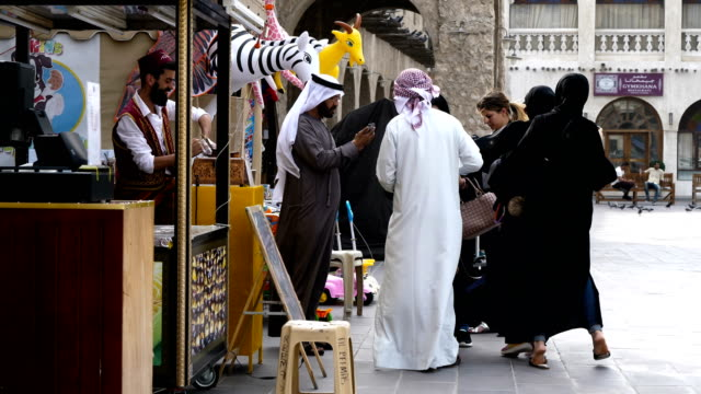 Arabic culture and city life at the Souq Waqif old market in Doha Qatar 4k resolution