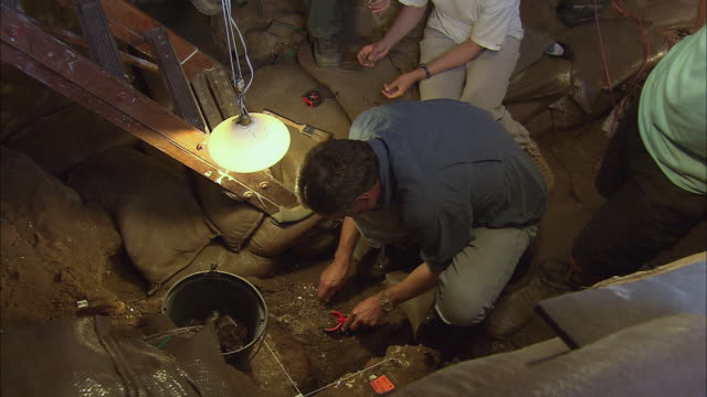 HA Archaeologists studying artifacts found in the Blombos Cave / South Africa